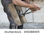 young horse farrier working in... | Shutterstock . vector #340388405