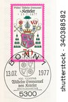 Small photo of GERMANY - CIRCA 1977: A postmark printed in Germany, shows Coat of Arms, Wilhelm Emmanuel von Ketteler (1811-1877), Bishop of Mainz, Reichstag member and social reformer, death centenary, circa 1977