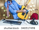 man playing guitar in office | Shutterstock . vector #340517498