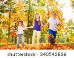 three kids hold hands playing... | Shutterstock . vector #340542836