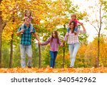 mom dad and little girls walk... | Shutterstock . vector #340542962