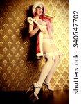 humorous sexy girl wearing pink ... | Shutterstock . vector #340547702