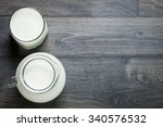 fresh milk on glasses bottle ...   Shutterstock . vector #340576532