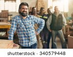 a smiling carpenter with his... | Shutterstock . vector #340579448