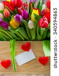 tulips in the box on wooden... | Shutterstock . vector #340594865
