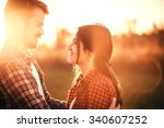 loving couple hugging outdoors... | Shutterstock . vector #340607252