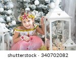 sweet cute girl looks at the... | Shutterstock . vector #340702082