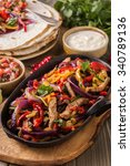 pork fajitas with onions and... | Shutterstock . vector #340789136