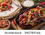 pork fajitas with onions and... | Shutterstock . vector #340789166