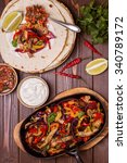 pork fajitas with onions and... | Shutterstock . vector #340789172