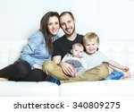 a young happy family with two... | Shutterstock . vector #340809275