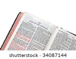 Small photo of holy bible open to the acts of the apostles, against a white background