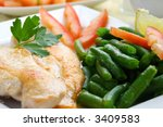 Roasted chicken medallions with vegetable - stock photo