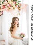 beautiful bride in long dress... | Shutterstock . vector #340976582