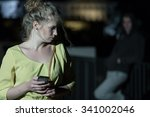 Small photo of Young woman wants to call the police