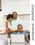 happy family using laptop in... | Shutterstock . vector #341092412
