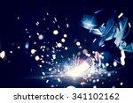 employee welding steel with... | Shutterstock . vector #341102162