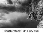 Small photo of Female climber struggeling up a sheer cliff.
