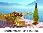 Wine And Grapes Against Geneva...