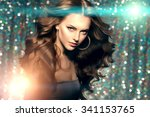Stock photo woman club lights party background dancing girl long hair waves 341153765