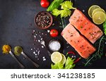 Raw salmon fillet and...