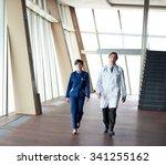 doctors team walking in modern... | Shutterstock . vector #341255162