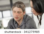 young coworkers working... | Shutterstock . vector #341275985