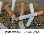 Cigarette Burning In Outdoors...