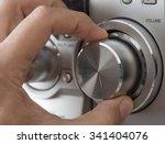 hand adjusting volume control.... | Shutterstock . vector #341404076