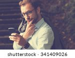 young handsome man using... | Shutterstock . vector #341409026