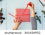 gift wrapping. woman packs... | Shutterstock . vector #341434952