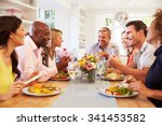 mature friends sitting around... | Shutterstock . vector #341453582