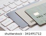 bank card on computer keyboard | Shutterstock . vector #341491712