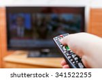 hand switches tv channels with... | Shutterstock . vector #341522255