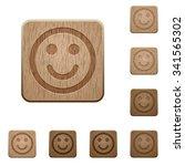 set of carved wooden smiley...