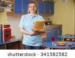 childcare worker standing in... | Shutterstock . vector #341582582
