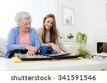 Elderly Woman With Her Young...