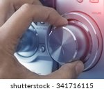 hand adjusting volume control.... | Shutterstock . vector #341716115