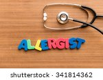 Small photo of allergist colorful word on the wooden background with stethoscope