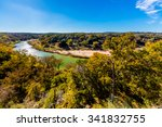 View of the Texas Pedernales River from a High Bluff.  With Fall Foliage and Blue Skies.