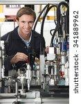 engineer working on machinery... | Shutterstock . vector #341889962
