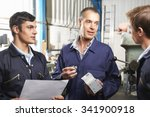 team of engineers having... | Shutterstock . vector #341900918