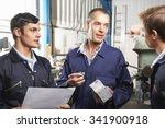 team of engineers having... | Shutterstock . vector #341900918