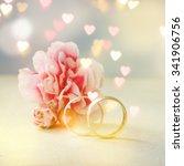 wedding ring against flower... | Shutterstock . vector #341906756