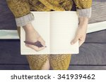 hipster girl with blank diary... | Shutterstock . vector #341939462