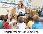 teacher using flash cards to... | Shutterstock . vector #342056498