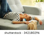 young woman lying on sofa and... | Shutterstock . vector #342180296