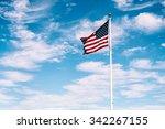 American Flag Waving Under A...