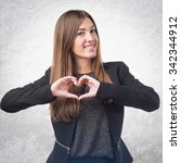 girl making a heart with her... | Shutterstock . vector #342344912