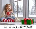 little girl sitting by the... | Shutterstock . vector #342392462
